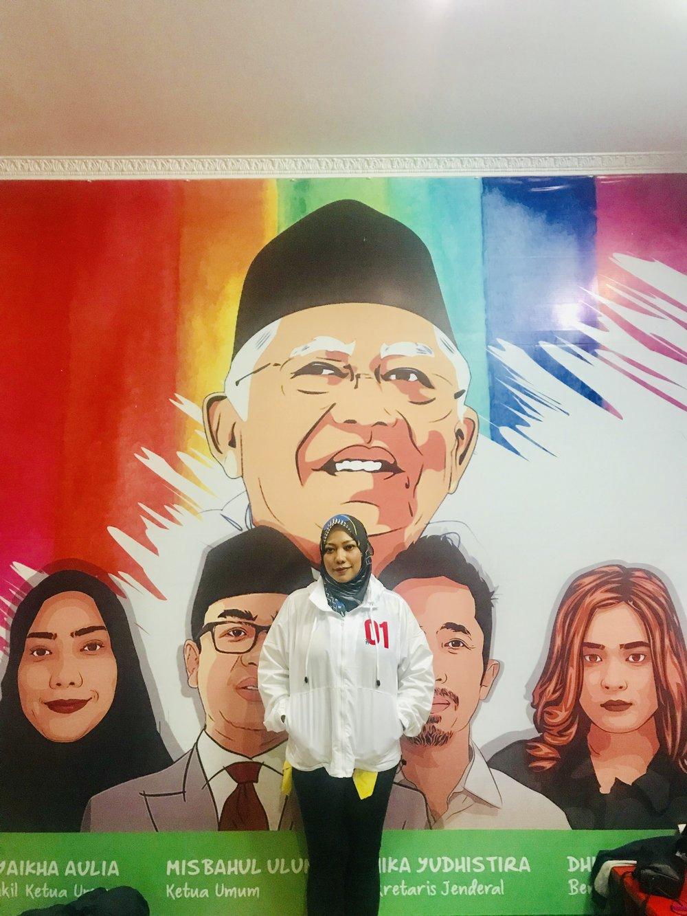 Amin's granddaughter Syaikha Aulia runs his election outreach to millennials. Photo by Sonia Sarkar.