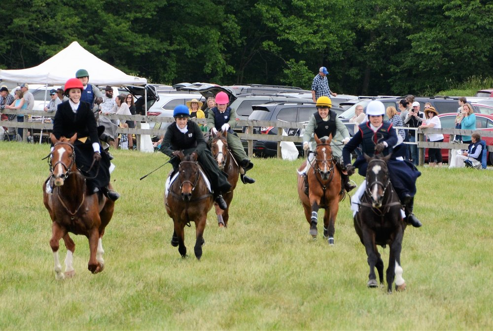 The top five horses were tightly bunched heading into the home stretch. From L to R: Reddington/Bernadette Boland, King of Hearts/Sarah Hansard, Easy to Say No/Aurora Munyan, The Gingerbread Man/Kathryn Cowles, In Todd We Trust/Devon Zebrovious. (c) Photo by Liz Callar
