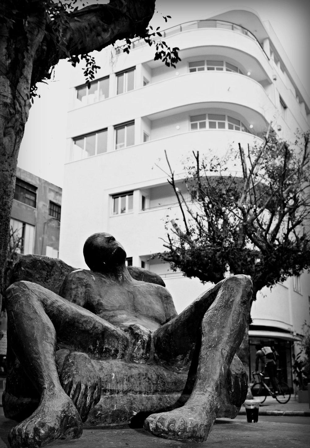 A Male Statue & Bauhaus Style Building