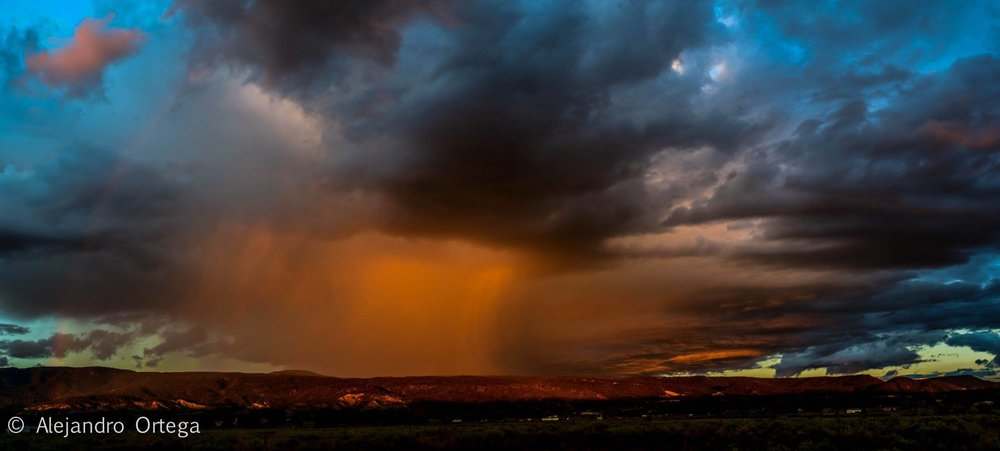View of a sunset summer storm on the Nacimiento Mountains from Cuba.