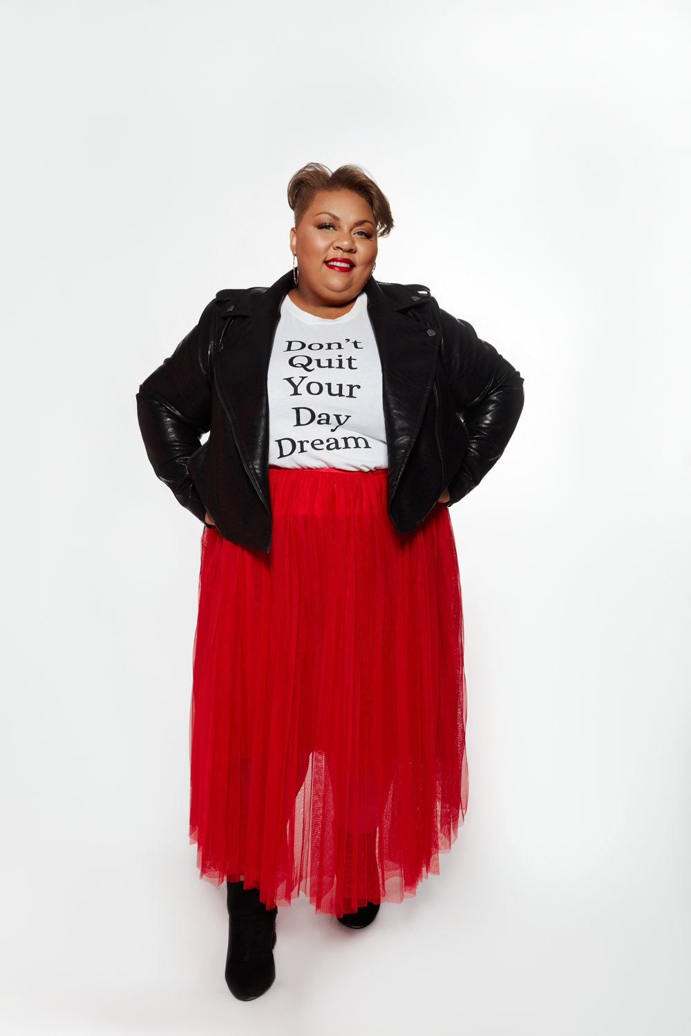 First Look: Don't Quit Your Daydream - I have to admit I'm obsessed with Tulle, so when Eloquii released this red tulle skirt I was all about it! I paired it with a graphic tee, Don't Quit Your Day Dream, which I felt was fitting for my personal mantra this year. Finished this look off with a black moto jacket, which is a new rocking staple to my wardrobe. I paired this look with a jeweled bootie, but trust me I'll be wearing some cute flats with this look as well. Shop the look here: graphic tee, red tulle skirt, and black moto jacket.