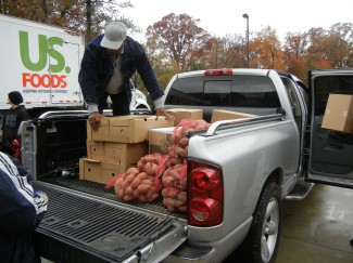 Loading up a truck with food to go out to a recipient agency