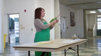 Volunteer Nutritionist Maria Garrido teaching the group about vegetables