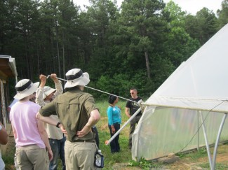 Bill showed the group how the sides can be rolled up or down to allow ventilation or to keep the heat inside.