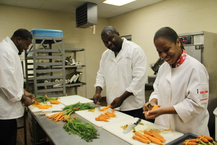 CJTP student prep carrots for the lunch-in