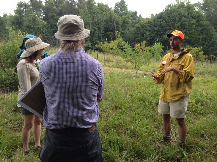 Chas Edens (right), director at Anathoth Community Garden & Farm in Cedar Grove (July 2014 CRAFT tour)