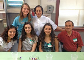 Maria with her family and Cooking Matters instructor, Becky Dobosy, at Maria's Culinary Job Training Program graduation