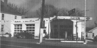 Photo of 902 Mangum St in the 1950's when it was a Gulf gas station. Photo from carolinafarmstewards.org