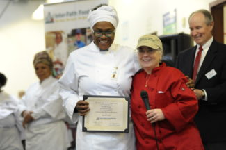 Gia Vincent receiving her diploma from Chef Terri at the 73rd Culinary Job Training Graduation