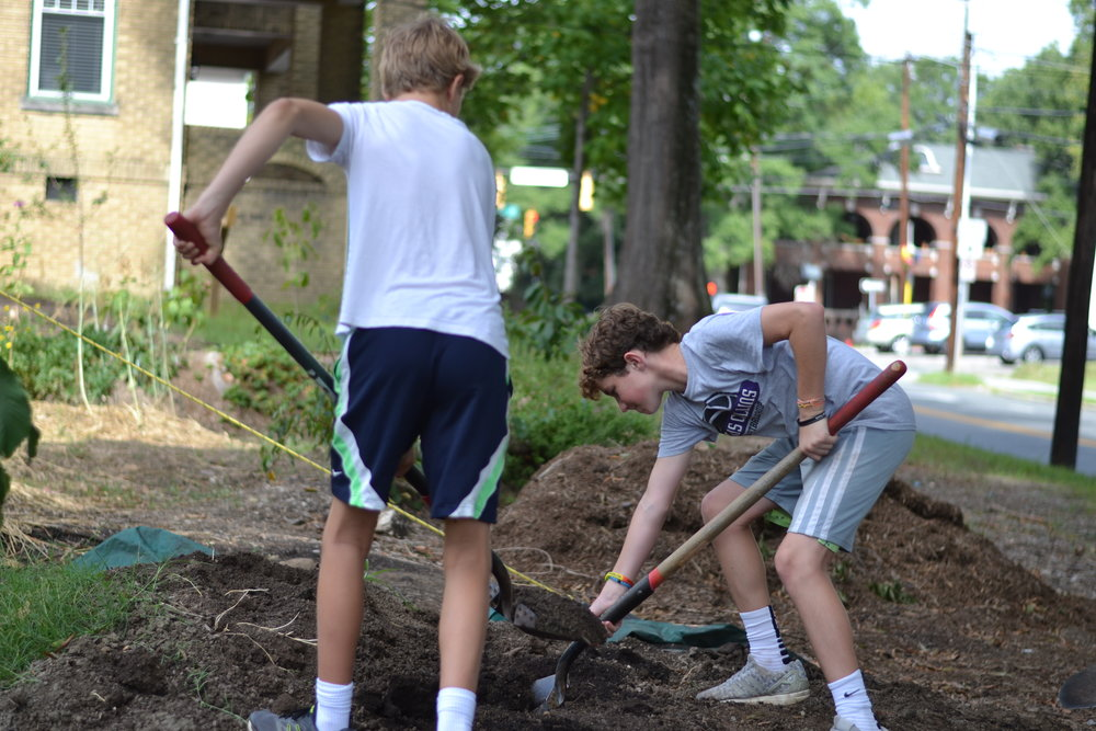 Durham Academy students work at the Geer Street Learning Garden
