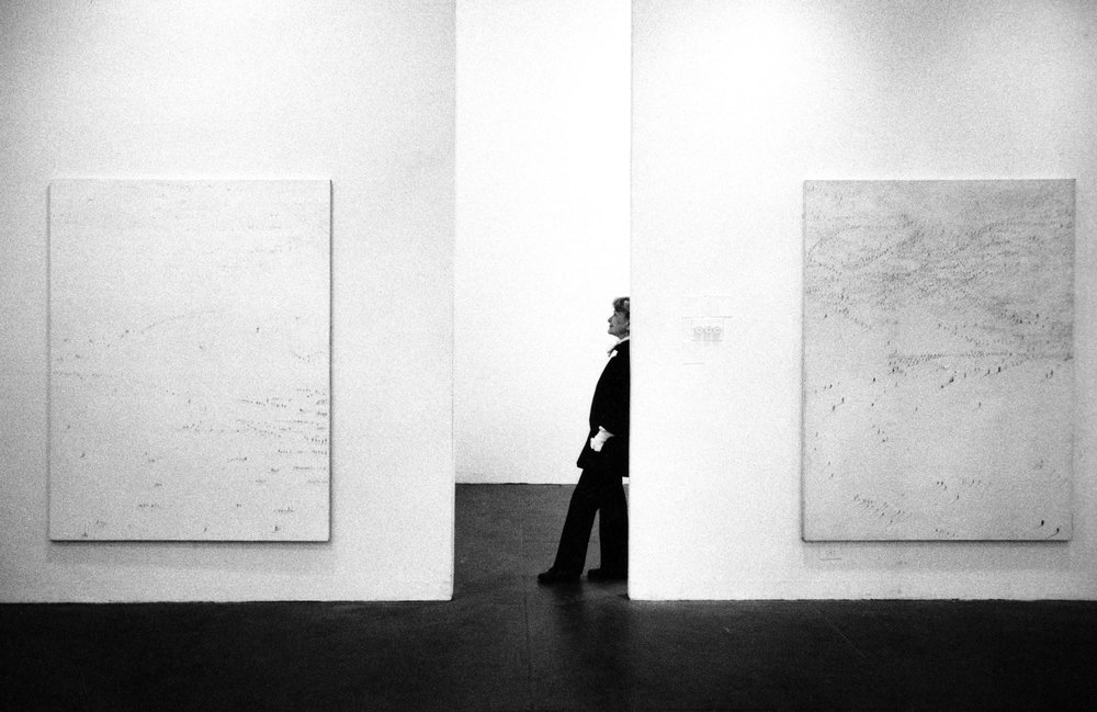 Photograph of Hedda Sterne at an exhibition of her work, c. 1982