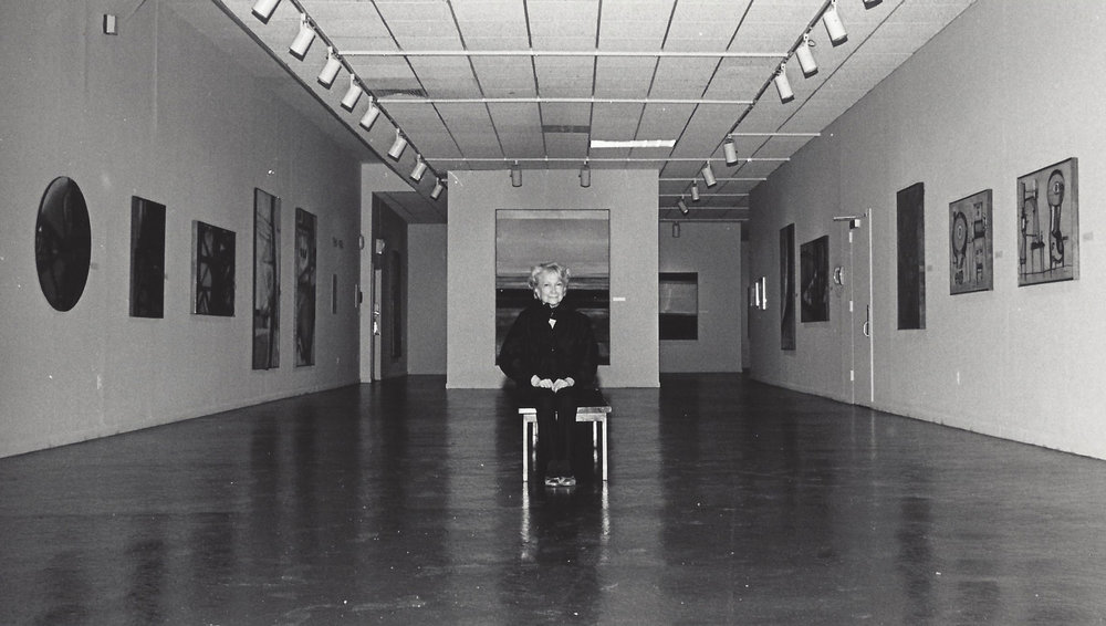 Hedda Sterne at her retrospective exhibition at the Queens Museum of Art, 1985.