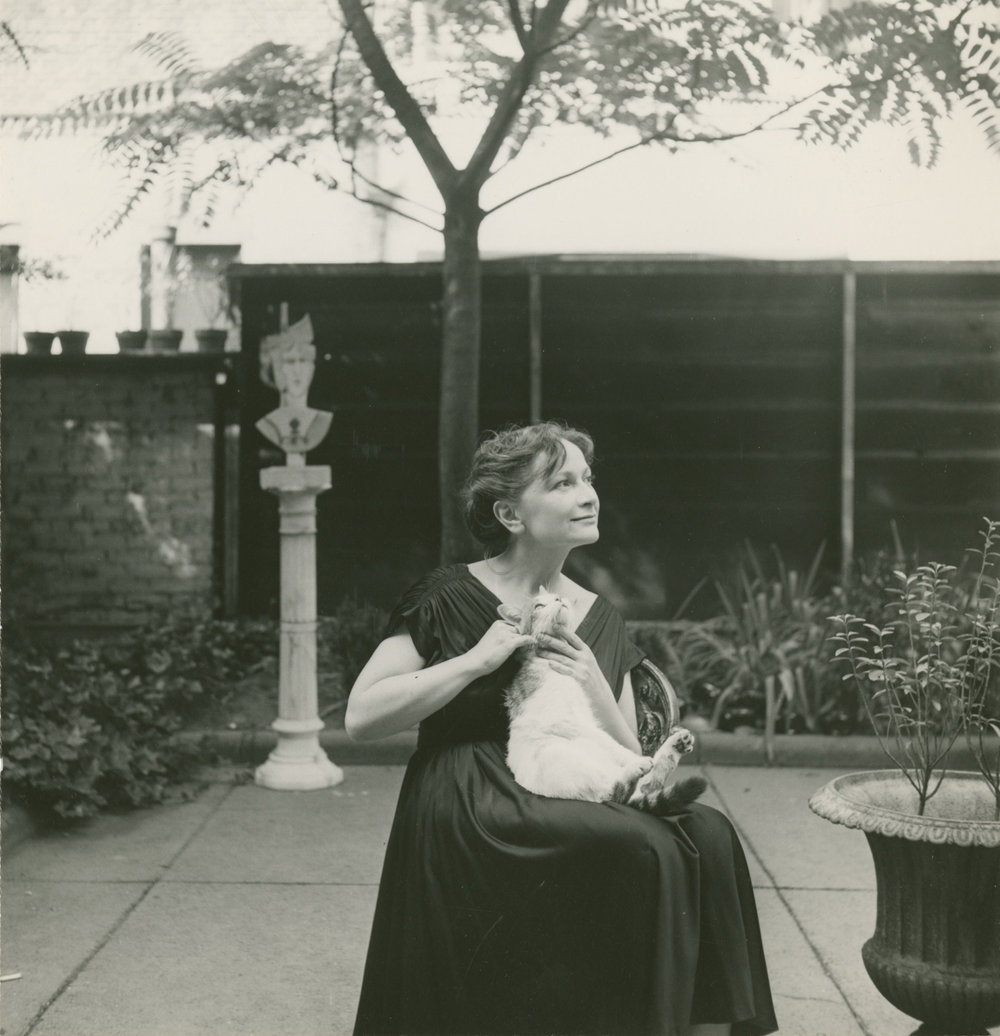 Hedda Sterne and her cat, Poussin, photographed in her garden on East 71st Street, New York, c. 1952 | photograph by Evelyn Hofer