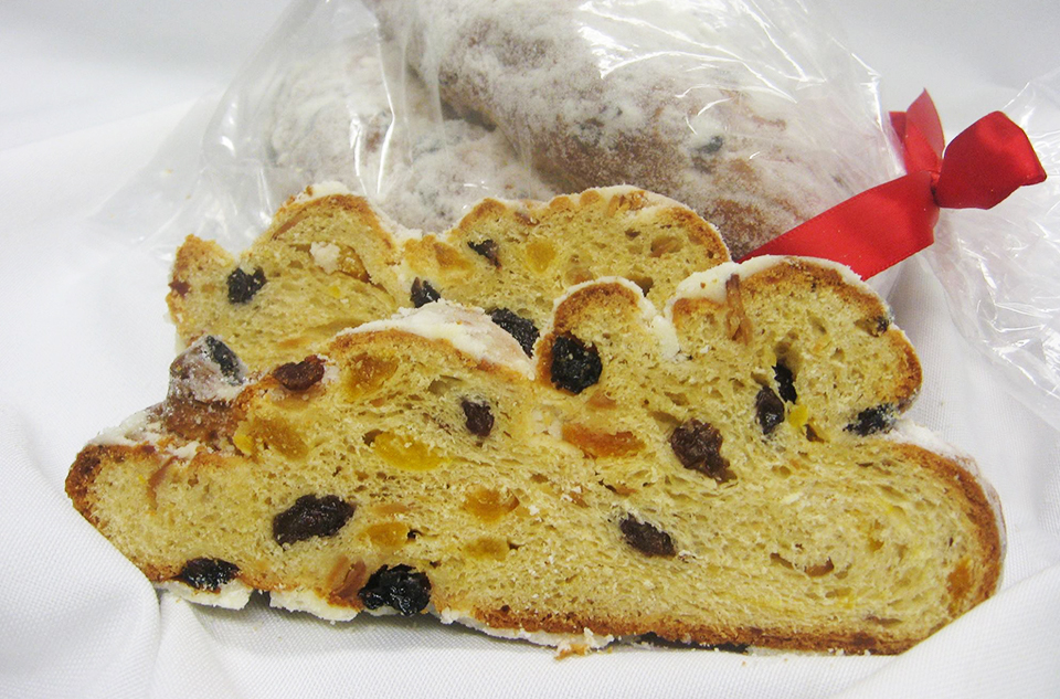 Winter Stollen - A sweet bread with raisins, cranberries and nuts. Baked, brushed in butter and rolled in sugar.