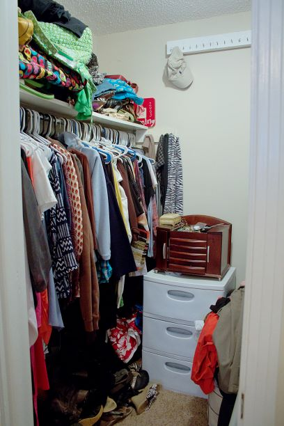 "This is our customer's ""Before"" closet picture. Notice the shoes thrown in the floor, a flimsy plastic bin used in place of wooden drawers and unused clothes just thrown on the top shelf? This is what most closets look like before our installs. You're not alone."