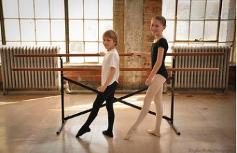 ballet basics - This class curriculum is geared towards 7 – 9 year olds as preparation for a more intense ballet program. Students will begin learning the basics of ballet, terminology, and theory of ballet movement.  There is a heavy emphasis on proper posture and body alignment, feet and arm positions, and a basic understanding and love of classical music.  Ballet Basics follows a professional children's ballet syllabus through the Cecchetti Council of America.  As dancers mature, students enrolled in this class may enroll in the Cecchetti program.  Ballet Basics is a 45 minute class held once a week.  There is also a