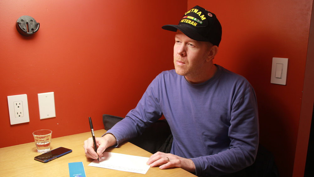 Vets hand-write their stories on the blank back and mail in pre-paid postcards for curation and aggregation.