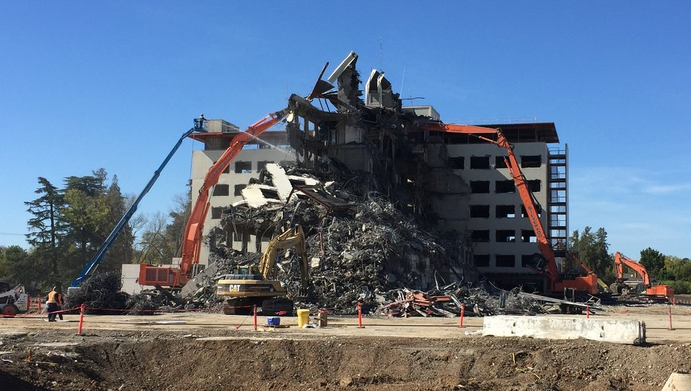 Building demolition progress...