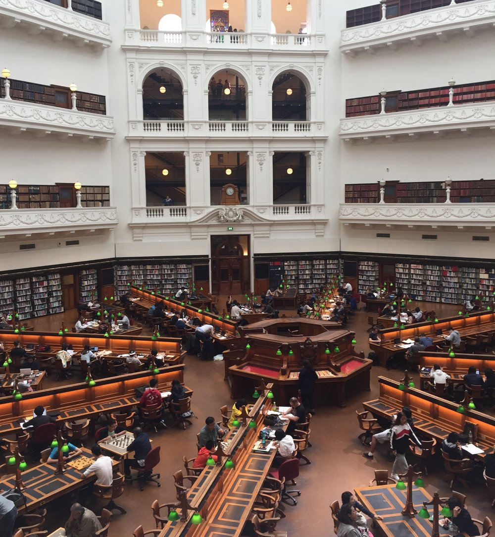 The main reading room at the State Library of Victoria. It's open to the public – many students use this space to study and members of the public use the available chess tables to challenge their minds. The top three levels contain stacks and exhibit space.
