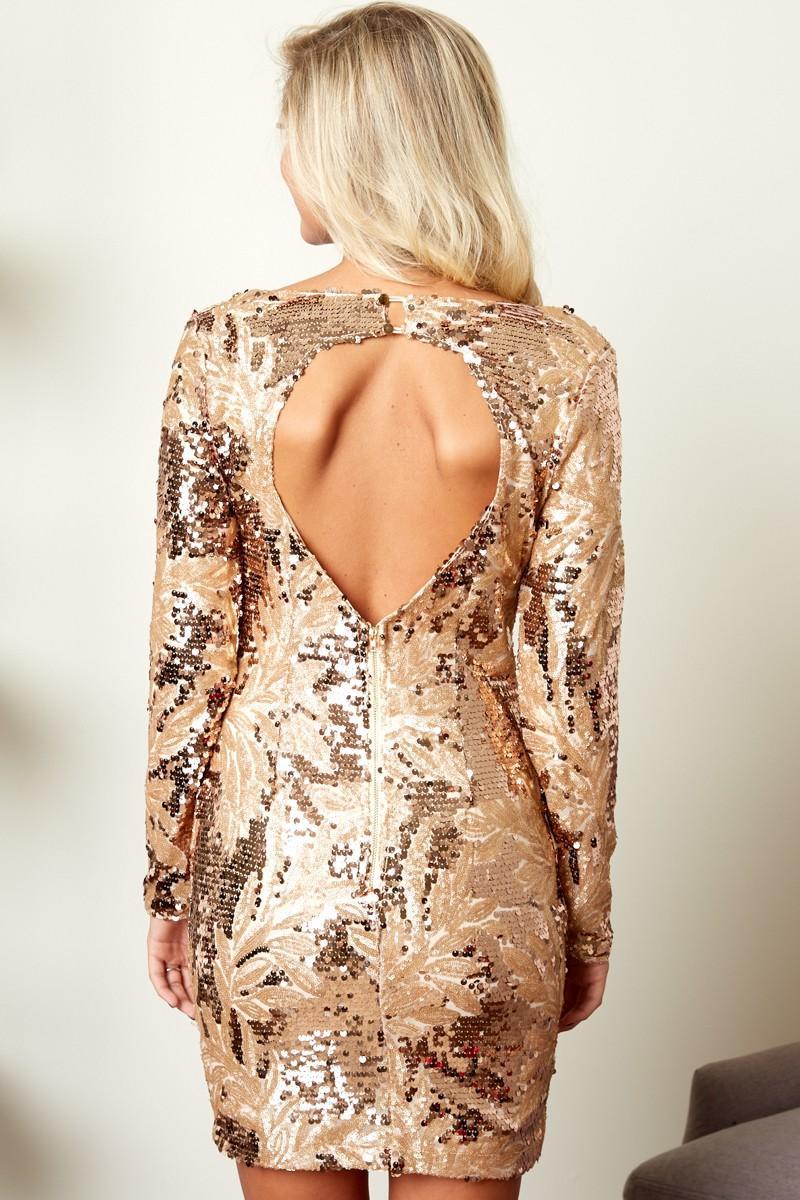 Girl in gold long sleeve dress