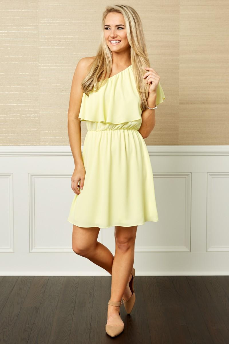 Model wearing one shoulder yellow graduation dress
