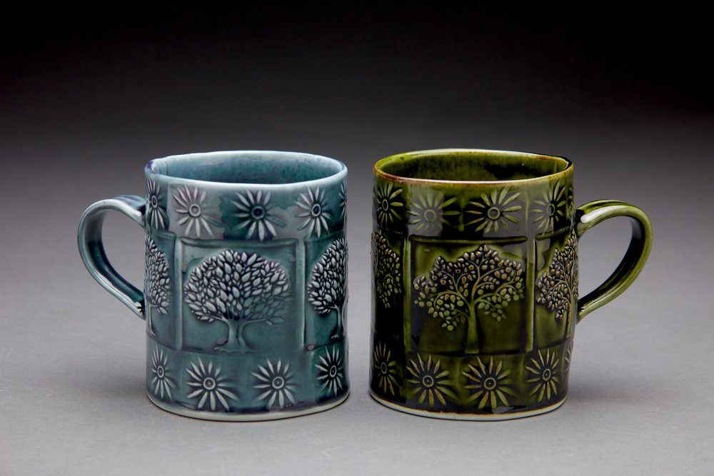 16 oz. mugs. 3.5x3.5x4 in. Persian Blue Glaze (left) Forest Green Glaze (right)