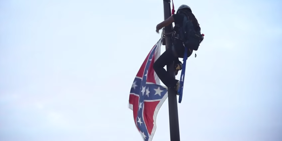 Bree Newsome taking down the Confederate Flag at the South Carolina Statehouse, via YouTube