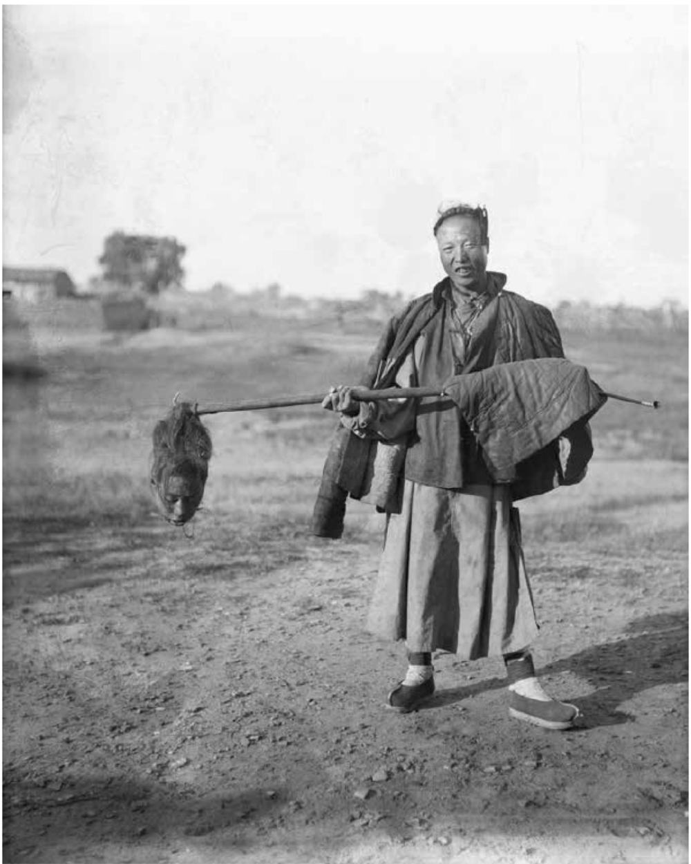 """The Chinese executioner, proud of his commission. Manchuria."""