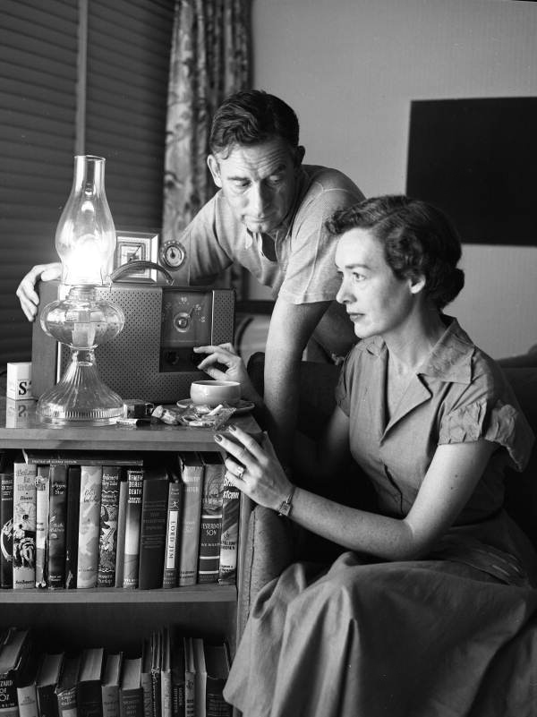 Philip Wylie at home with his wife listening to the radio for weather reports in Miami, Florida, 1950, photographed for  The Saturday Evening Post  by Joseph Steinmetz.