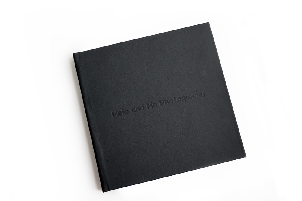 Pictured: A 12x12 custom designed album with a genuine Italian leather cover and debossing.