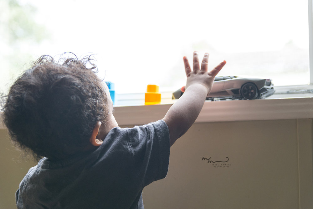 Rainbow baby, Jaxon, reaching for his toy car. I refer to him as a rainbow, because they often appear after heavy storms. Hence, a beautiful baby after my stillbirth.