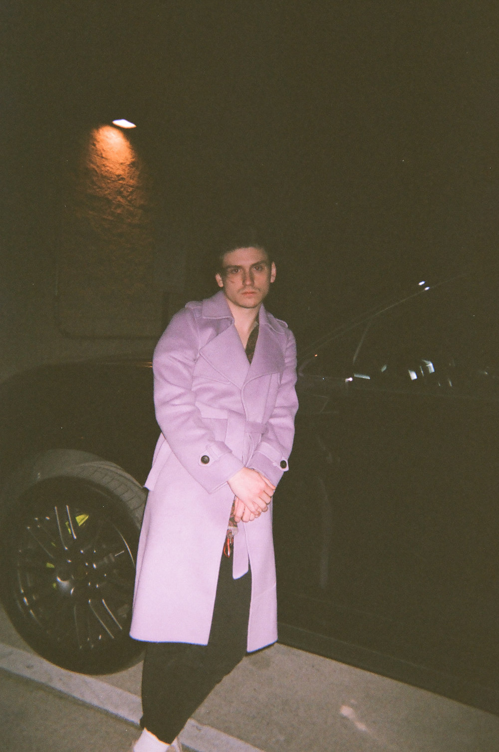 Our keyboardist Jack sporting a lavender trench coat.