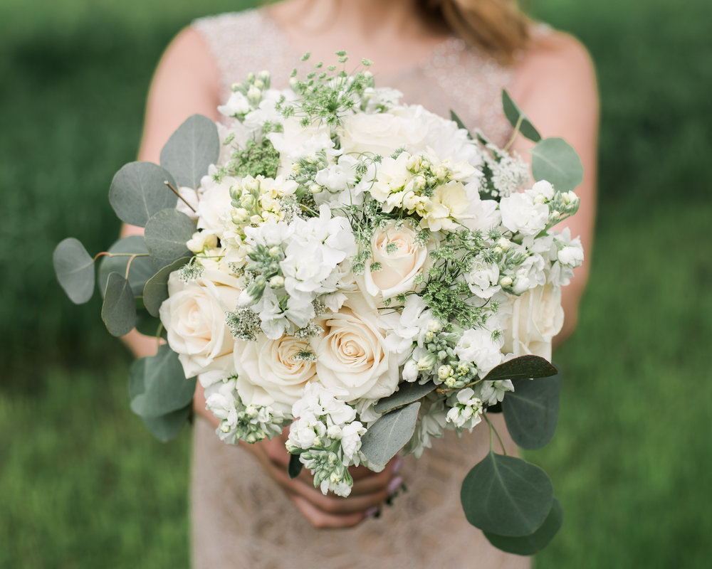 Roses, Eucalyptus and queen annes lace make this romantic garden feel bouquet perfect for any bride!