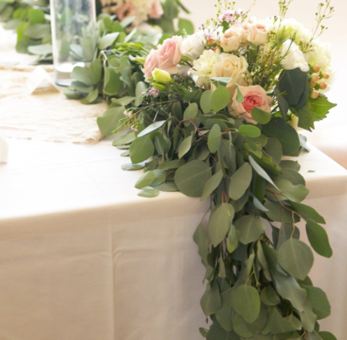 The garland on the head table. Photo by Natalie Donovan @  www.nkd-creative.com