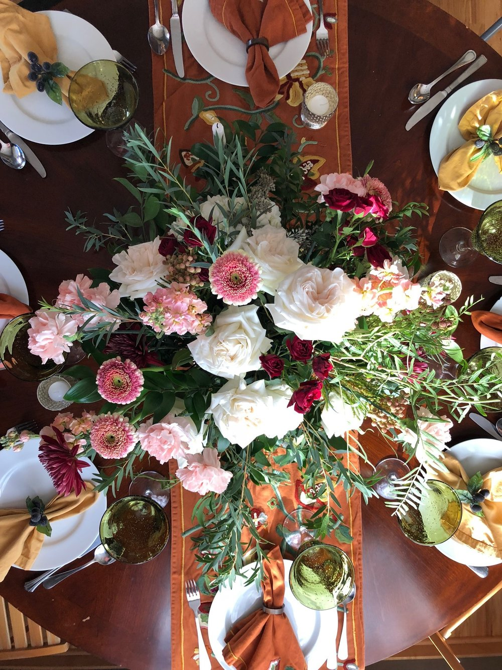 The Thanksgiving table setting was extra special this year! Who says you can't have pink flowers on Thanksgiving!