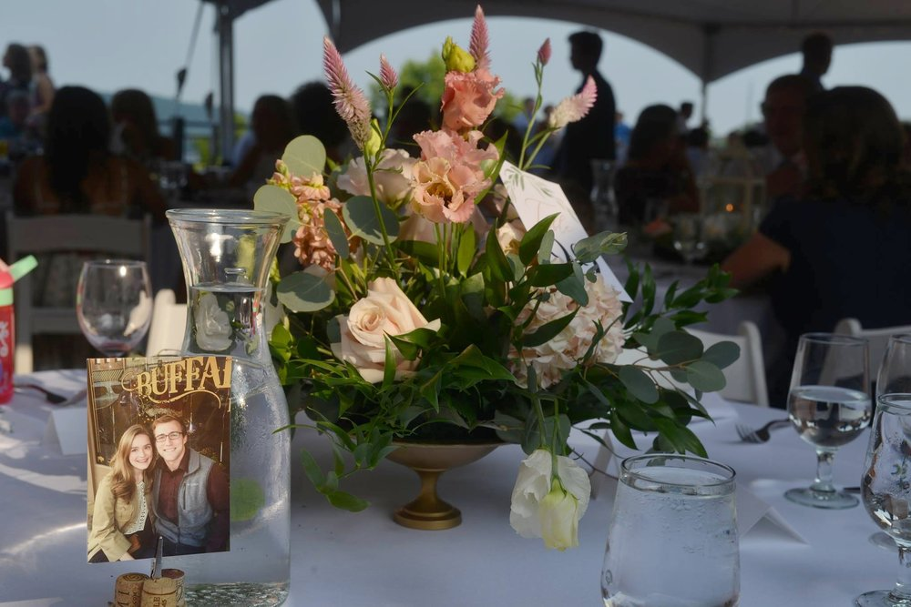 The centerpieces at sunset on the rooftop reception site! Stunning!  Photo credit: Genuine Photography By Meyer