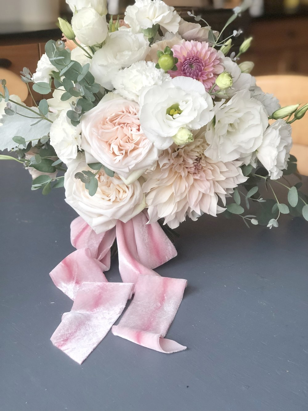 We love the to support local Stillwater businesses. For this wedding we used flowers from Arcola Trail Flower Farm and Rose Mille a local vintage shop for the ribbons!