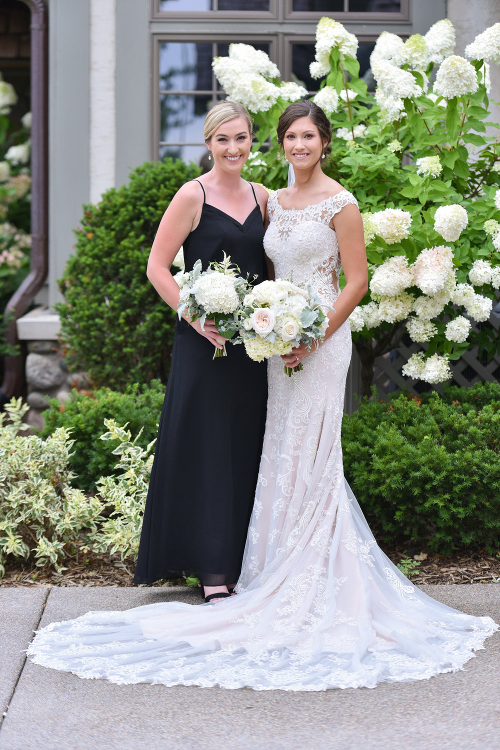 Here is one of the Flower Girls, Hailey, with the beautiful bride Mary. They grew up playing golf together, and their families are friends.