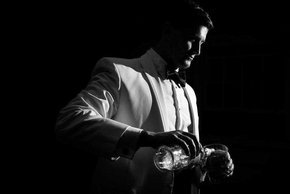 040groom-pouring-alcohol.jpg