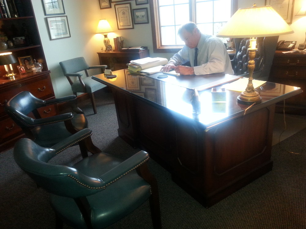 W. Randall Rock Attorney at Law working at his office desk