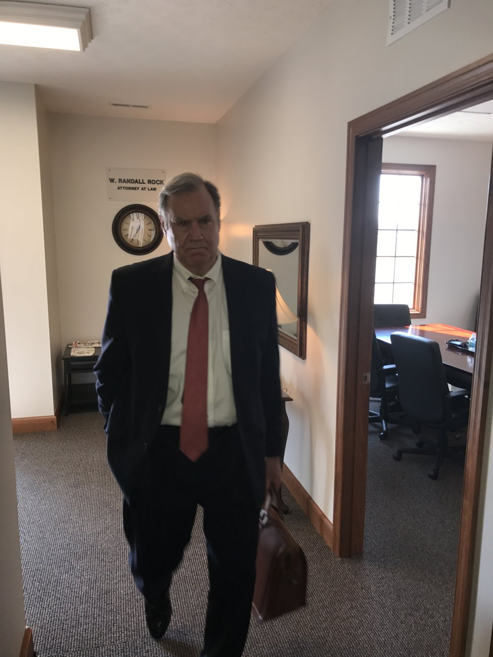 W. Randall Rock Attorney at Law walking in his office after arguing a case in court