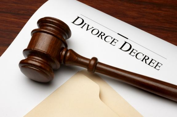 A divorce decree with a judges gavel and person thinking about modifiying their divorce dissolution legal separation final decree and enforcing the decree through contempt needing a divorce dissolution legal separation modification and contempt attorney