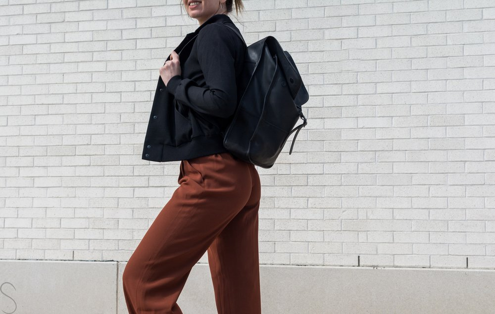 rust wide legged pants artizia rains commuter bag Wilfred poussin jacket