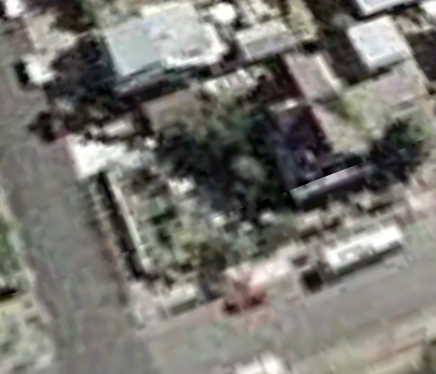 July 2001.  Obviously, satellite imagery is getting a little rough as we move back in time. It's interesting that the images get clearer after 2001. Two things happened that year that may have influenced this trend: 9/11 and the release of Google Earth on June 11 2001. Or maybe it was just the forward march of technology in general. You can still make out the RV on the street. It may just be an artifact of the low resolution but it looks like the fence line doesn't extend all the way to the garage. I know Jim built the fence and I think it was finished by the time this picture was taken but maybe he was still wrapping it up.