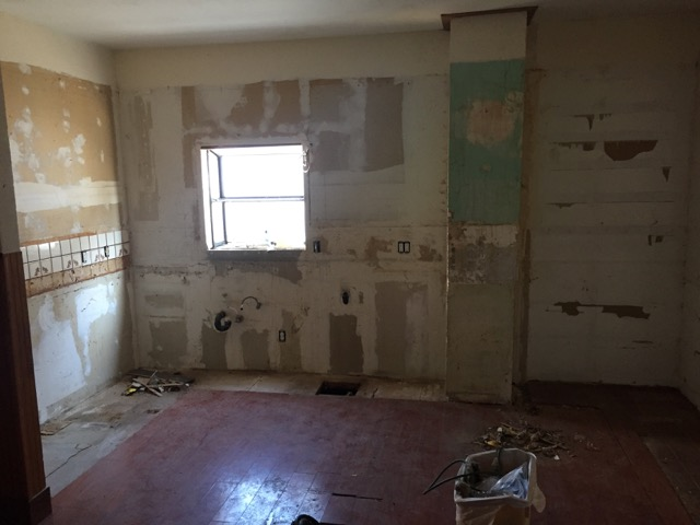 The kitchen cabinetry, counters and appliances have all been removed.  Everything you see here will get demo'd to the studs next week.