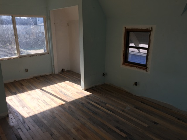... and this.  The floors are not consistent and are heavily damaged throughout the house.  We want to try to save anything we can but it seems unlikely that we can salvage any flooring.