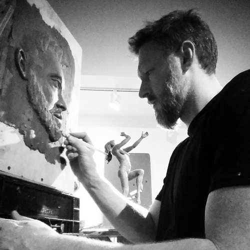 Carl Goines artist working with clay