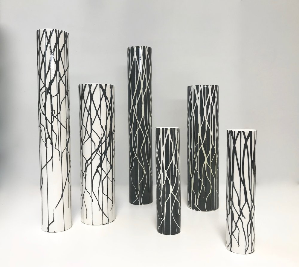 Silhouette Vases are high fired porcelain ceramic cylinders with a hand painted decorative glaze, either black on white or white on black  Materials: Ceramic  Dimensions: Tall Vase – 500mm tall x 80mm diameter (approx)  $269  Large Vase – 400mm tall x 100mm diameter (approx) $269  Small Vase – 250mm tall x 60mm diameter (approx)   $149