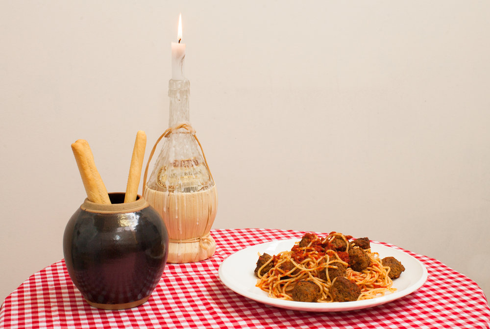 Christina Peek,  Most Passionate, Most Pure Kiss #1 (Lady and the Tramp)    (detail),  2017, backdrop, spagehtti and meatballs, tablecloth, table, chianti bottle, candle, pot, breadsticks, dimensions variable, photography by Alycia Bennett
