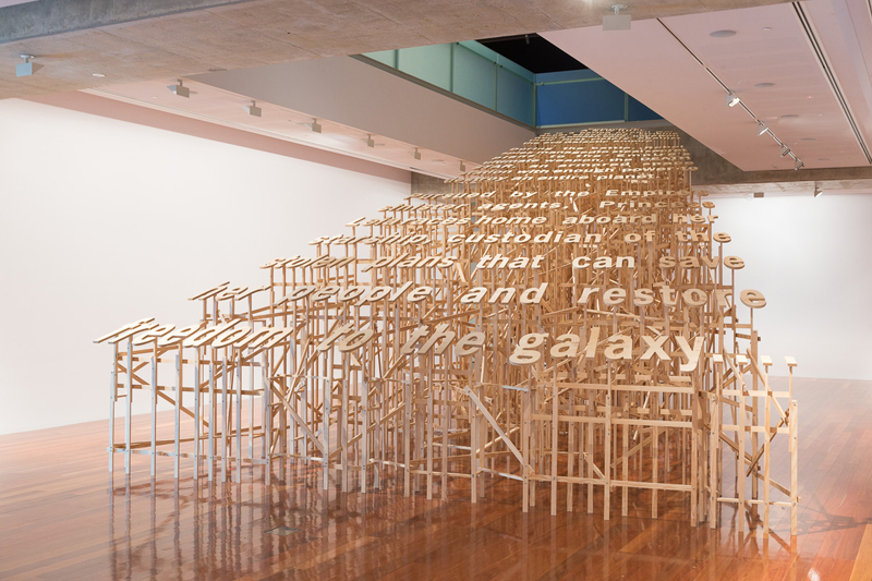 Roy Ananda,  Slow crawl into infinity . 2014. Plywood, timber, fixings. 550x1100x700cm. Photograph by James Field